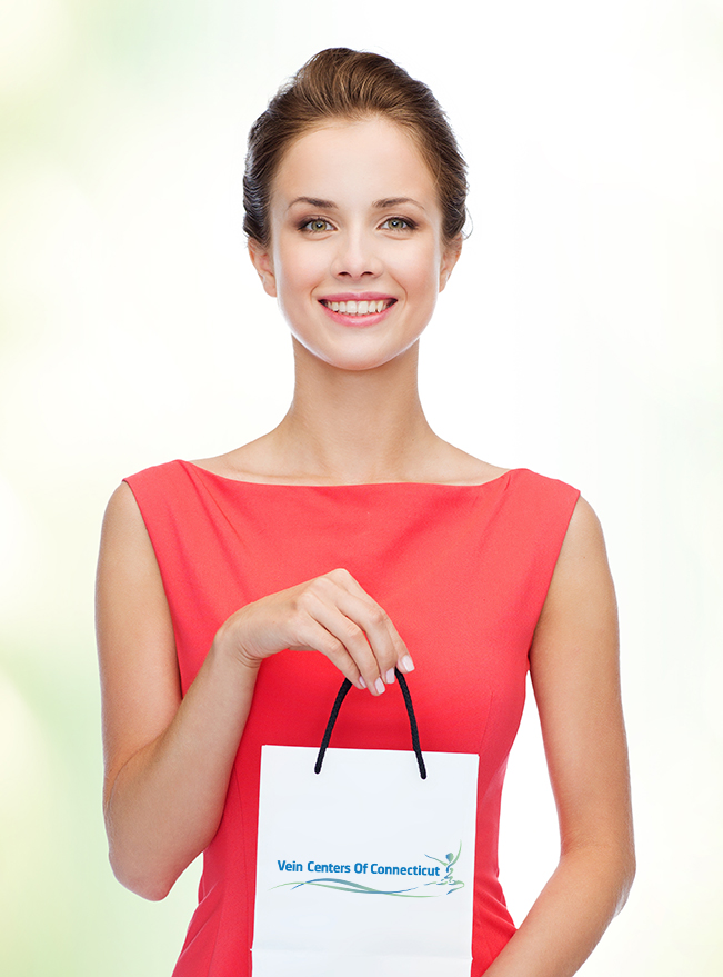 Woman holding small shopping bag