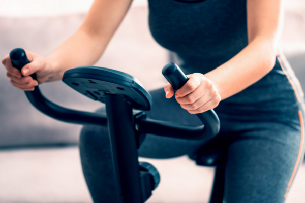 closeup woman on stationary bike