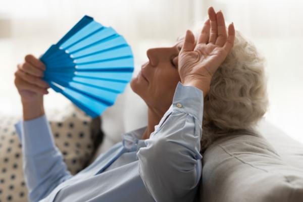senior woman fanning herself